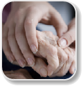 Image of holding a elder persons hand for caregiving